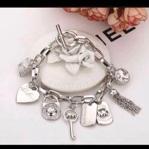 MK 7 Charms in silver bracelet